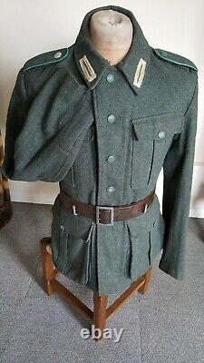 Ww2 German uniform m40 combat tunic with badges in perfect condition